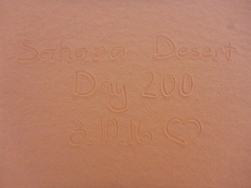 """200 Days"" written in sand"
