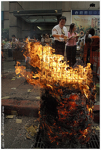 burning paper money at Chinese Ghost Festival... | by *dans
