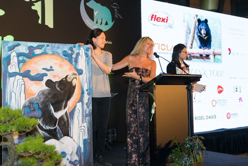 Artist Nini Sum, Jill Robinson and Karen Mok on stage