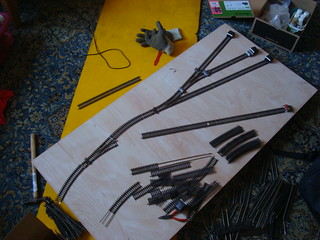 Model railway track laid out on baseboard