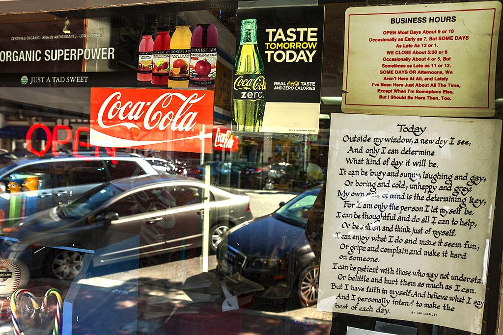 Eccentric-business-hours-sign--San-Mateo