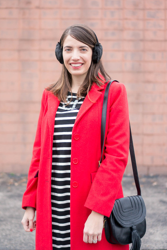red coat + black stripe dress + black tassel purse + black earmuffs + black chelsea boots | Style On Target blog