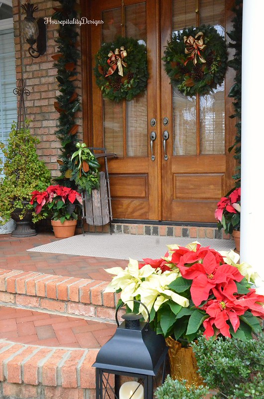 Christmas-Porch-Poinsettias-Lantern-Housepitality Designs