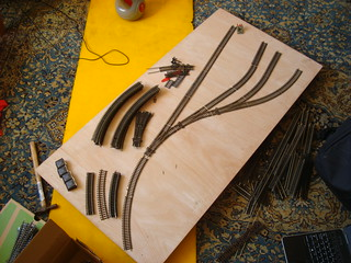 Model railway track on baseboard