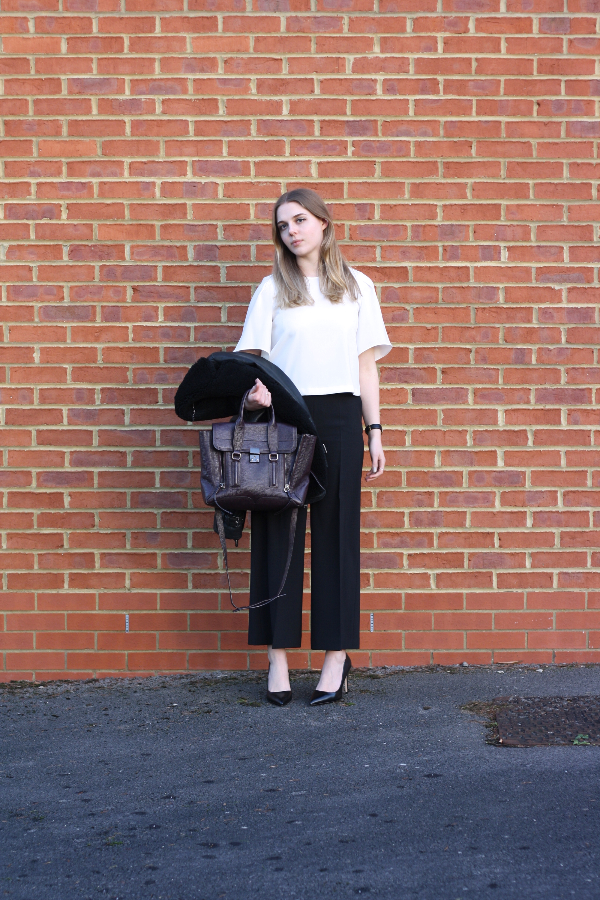 Zara white fluted sleeve top and Zara black culottes