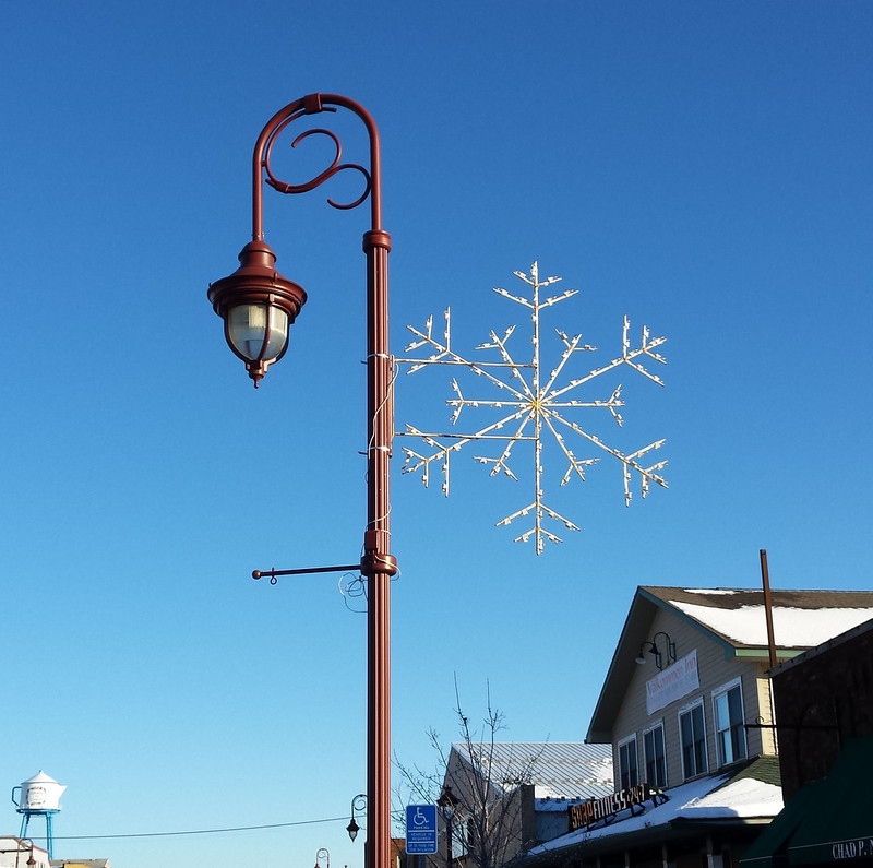 sunny snowflake on the lamp post, with the coffee pot water tower in the background