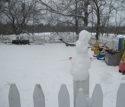 snowman on a fence post