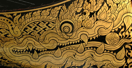 A paining in gold of a dragon adorns a royal dragon boat in Bangkok, Thailand