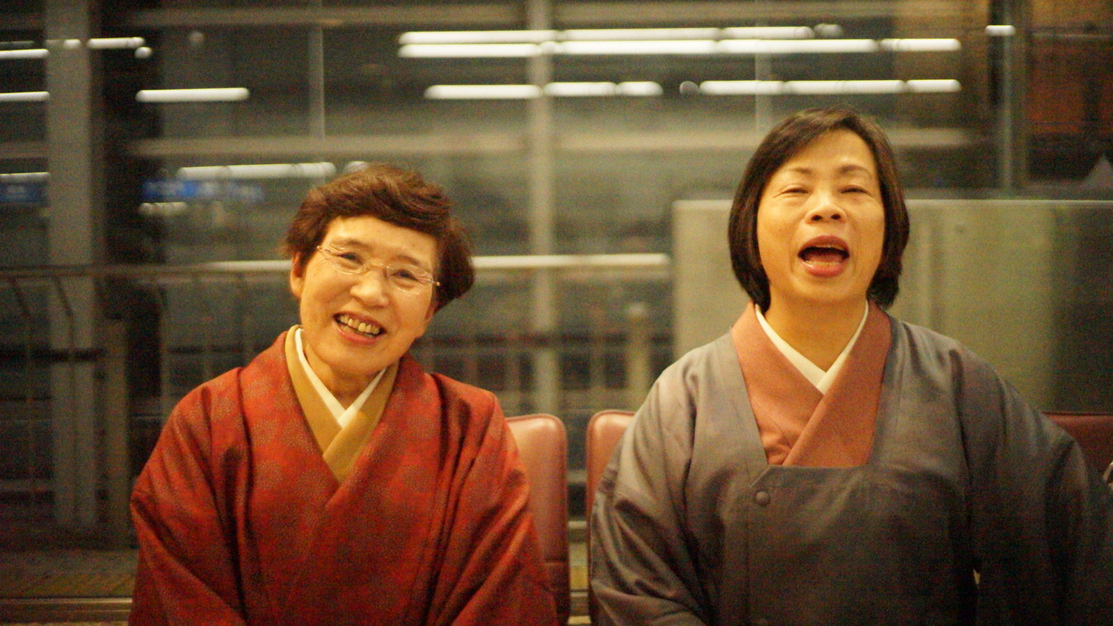 I saw these two in the waiting room for the Shinkansen having a laugh so I asked if I could take their photo.