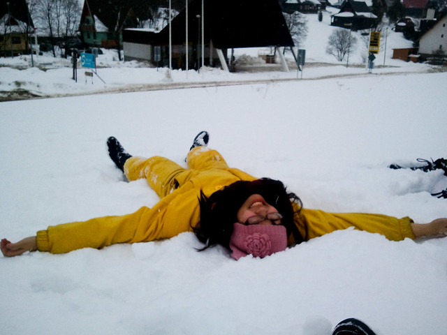 Adelina making snow angels in Zdiar, Slovakia