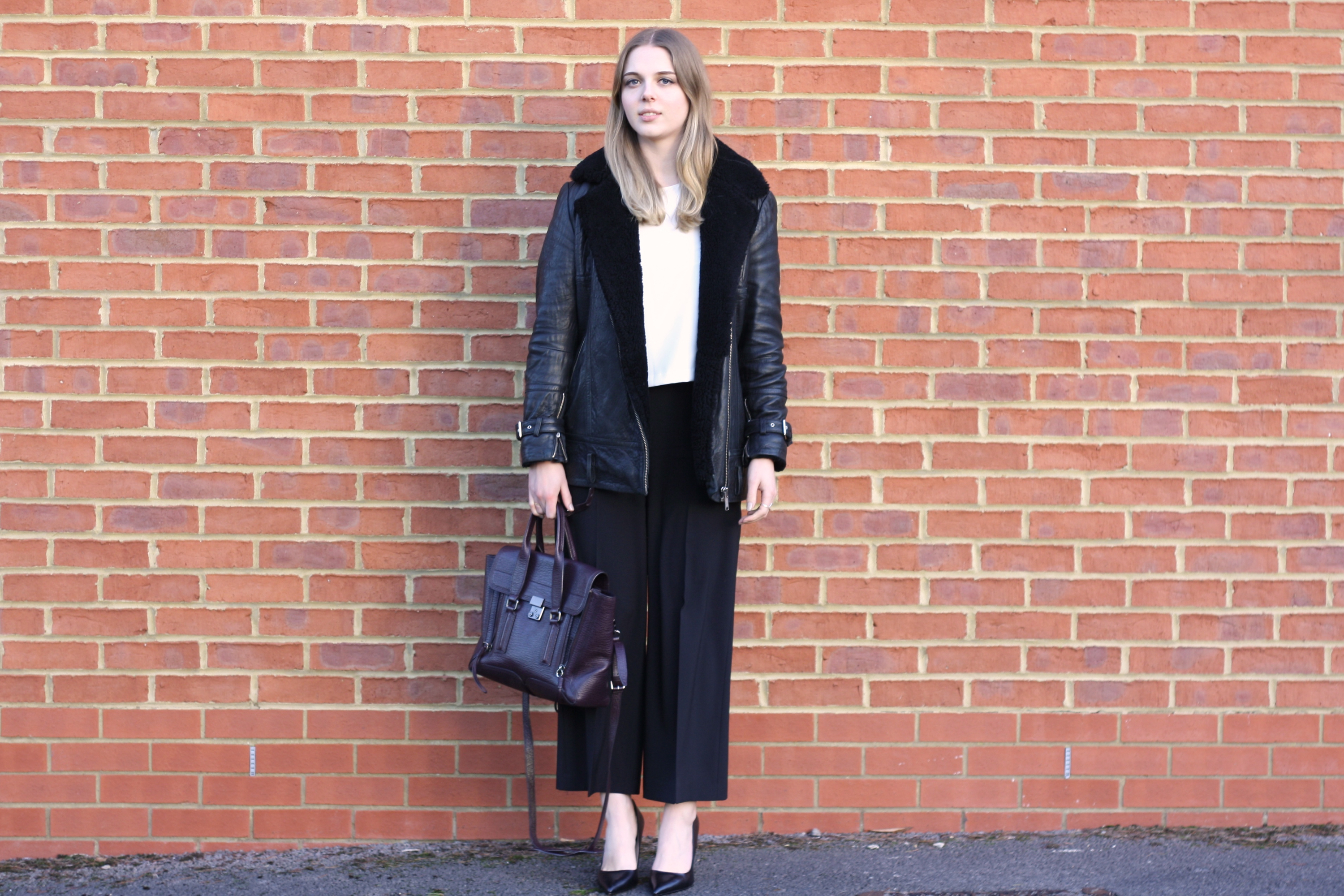 Whistles shearling leather jacket and Zara wide legged trousers