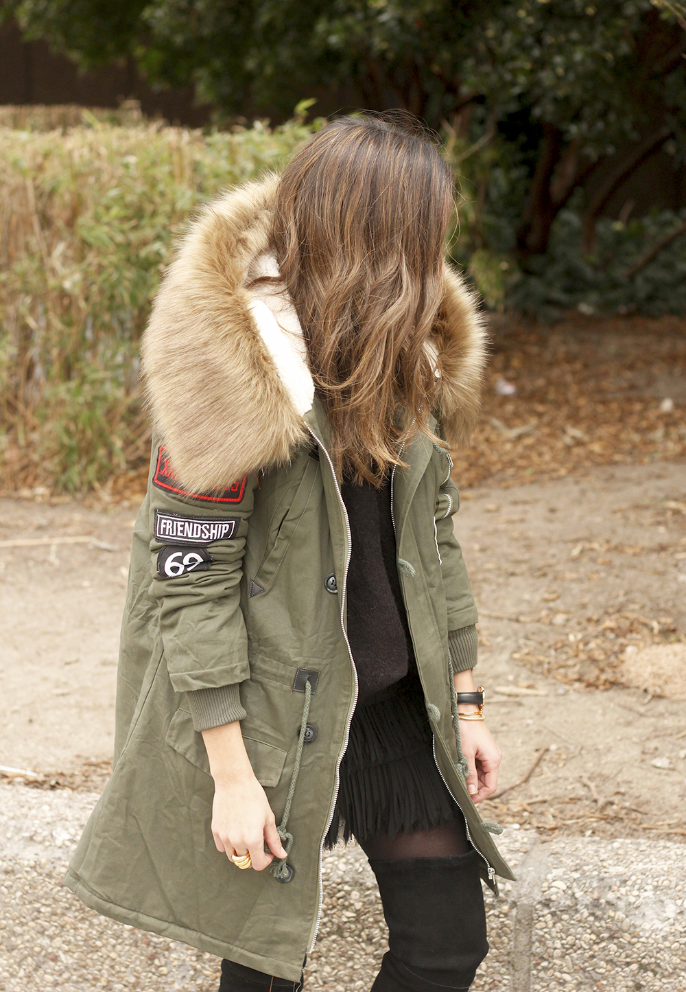 Green Parka black skirt over the knee boots winter style outfit06