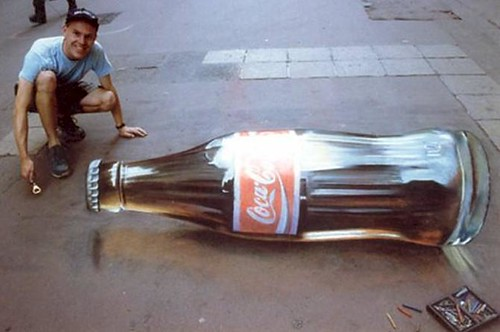 "Example Of 3D Sidewalk Art: A ""Coca-Cola Bottle"" Lies On The Sidewalk! 