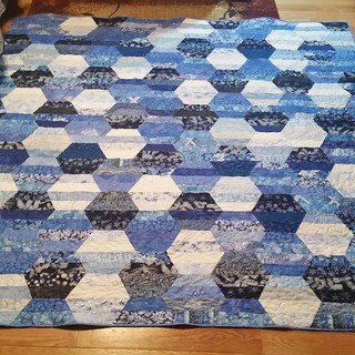 The Blue Hexie quilt is done! Feeling a great sense of accomplishment in completing this one. Made entirely from mom's stash.