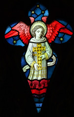 angel carrying a cross