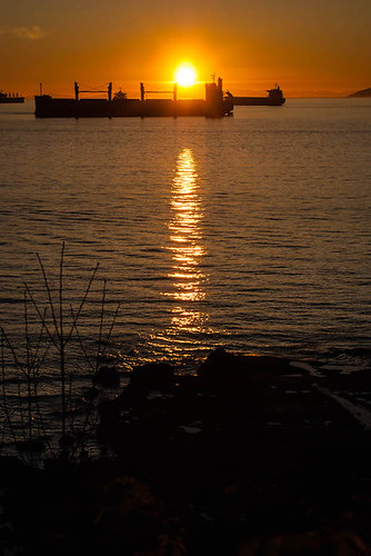 Sunset over Cargo Ships