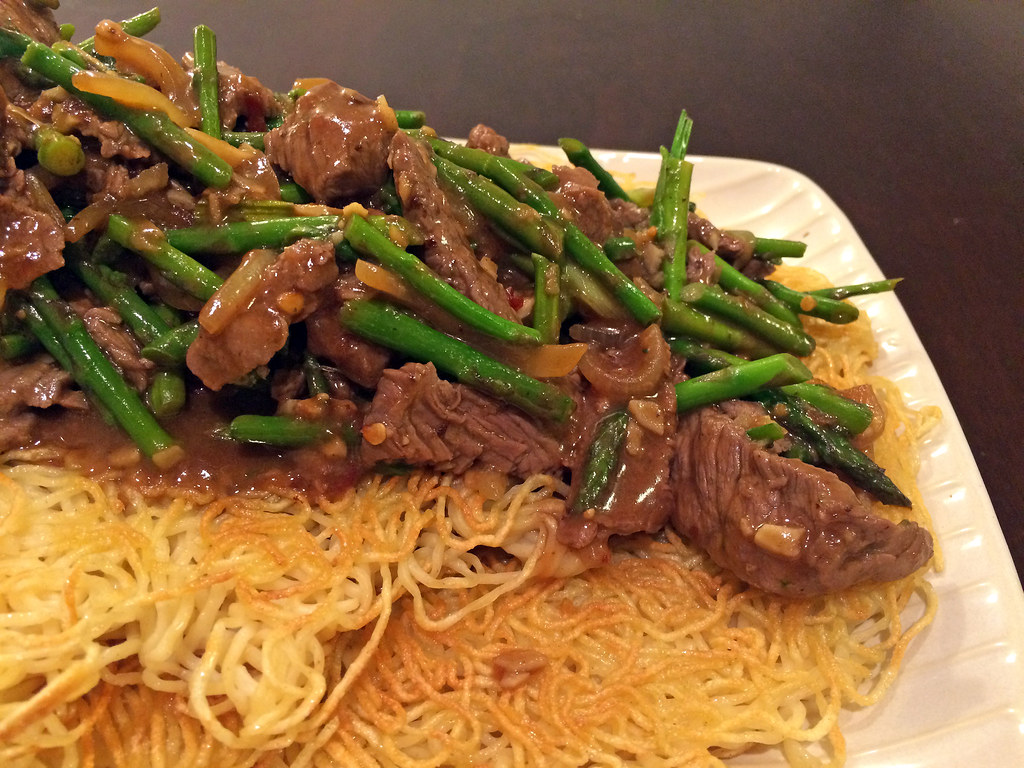 Beef and asparagus stir-fry with noodle pancake