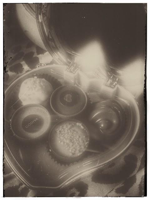 noir chocolate; noir shot of inside heart shaped Godiva tin
