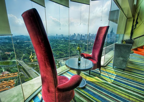 The Electric Red High-Backed Chairs where I Eat Breakfast in Kuala Lumpur | by Stuck in Customs