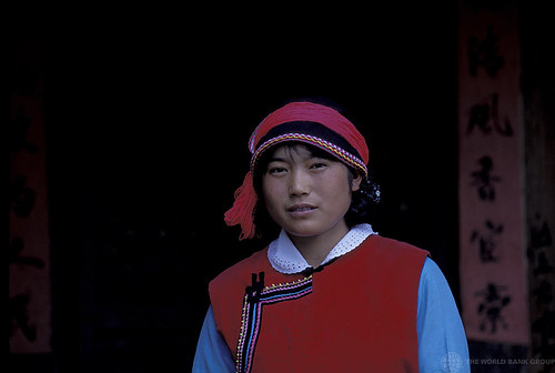 Portrait of woman in traditional outfit. China | by World Bank Photo Collection