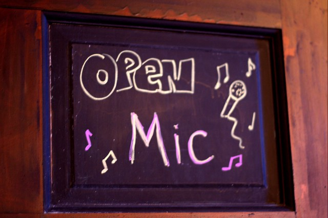 """Open mic"" sign on the bathroom door"