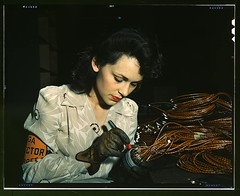 Woman aircraft worker, Vega Aircraft Corporation, Burbank, Calif. Shown checking electrical assemblies  (LOC) | by The Library of Congress