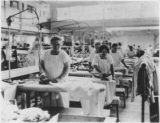 Older Women Doing Hand Ironing in Laundry Where General Lay-Out Is Good, But Women Apparently Have No Seats | by The U.S. National Archives