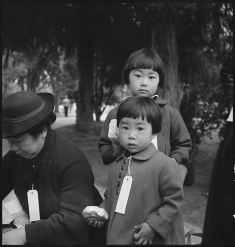 Two Children of the Mochida Family, with Their Parents, Awaiting Evacuation Bus | by The U.S. National Archives
