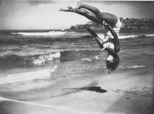 Peggy Bacon in mid-air backflip, Bondi Beach, Sydney, 6/2/1937 / by Ted Hood | by State Library of New South Wales collection