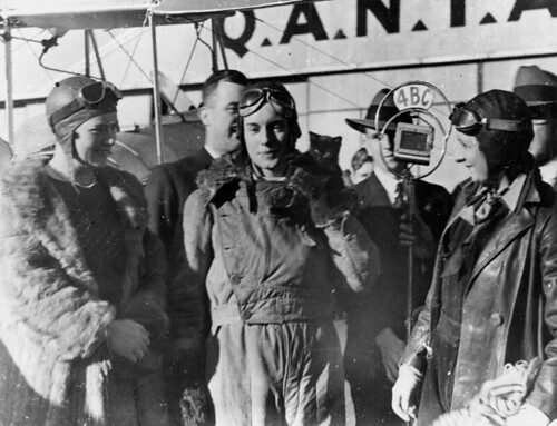 Aviatrix Jean Batten being interviewed after her flight from England to Australia, 1934. | by State Library of Queensland, Australia