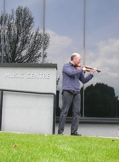 44th of 2nd 365: Me playing the violin outside the Churchill College Music Centre at the University of Cambridge | by dumbledad