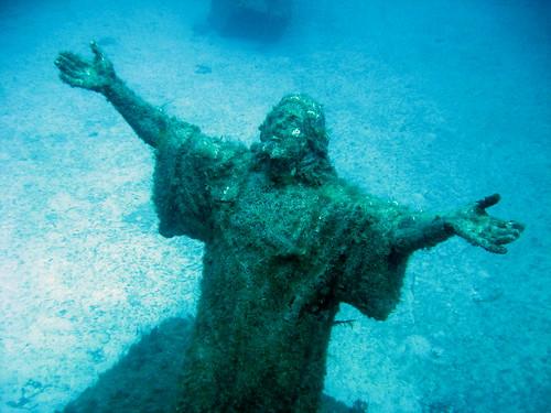Submerged Christ statue