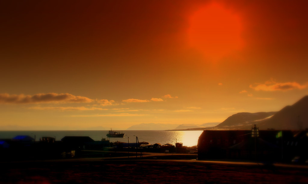 THE MIDNIGHT SUN OVER LONGYEARBYEN SVALBARD SPITZBERGEN 78 DEGREES NORTH NORWAY JUNE 2014