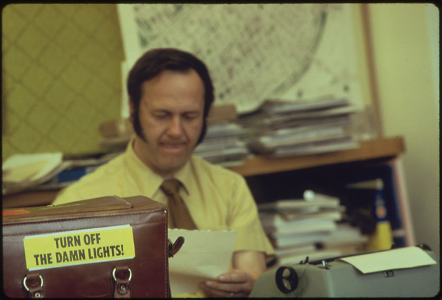 """Turn Off the Damn Lights"" Stickers Mirrored the Seriousness of the Energy Situation in Oregon During the Fall of 1973. This Sticker, in a Portland Business Office, Was Used in Newspaper Ads as Well as on Television, Billboards and Car Bumpers 10/1973"