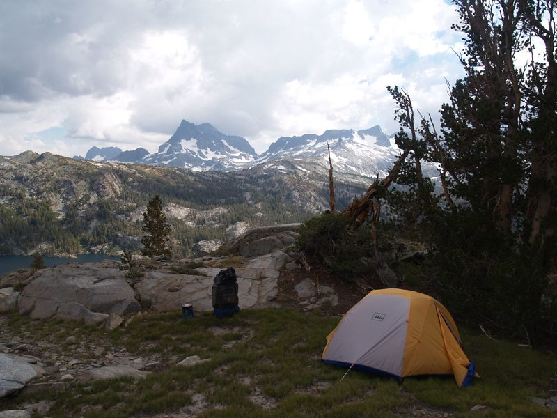 Our tent and campsite with heavy clouds above Banner and Ritter.