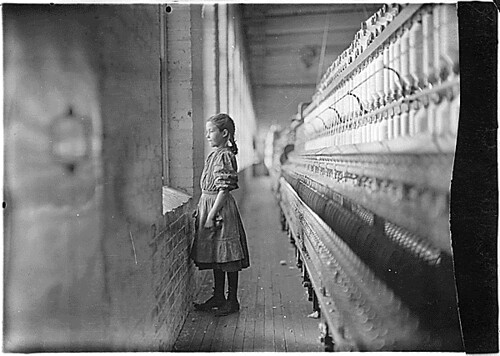 Rhodes Mfg. Co. Spinner. A moments glimpse of the outer world. Said she was 11 years old. Been working over a year. Lincolnton, N.C., 11/11/1908 | by The U.S. National Archives