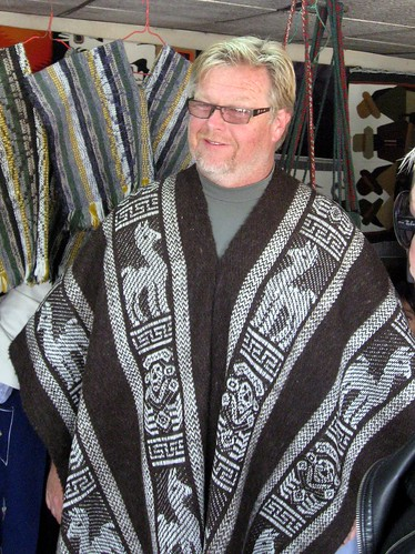 David trying on poncho | by ecuadorliving
