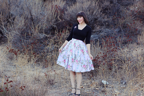 Pinup Girl Clothing Pinup Couture Jenny Skirt in Floral Ribbon Print Heart of Haute Sweet Sweater in Black