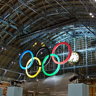 The moment the 2012 Olympic Rings at St Pancras are unveiled - the white cover shimmers to the floor (6.39 pm, 3 March 2011) | by chrisjohnbeckett