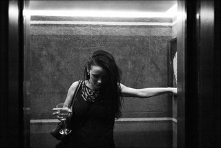 in the hotel elevator with wine glass | by gorbot.