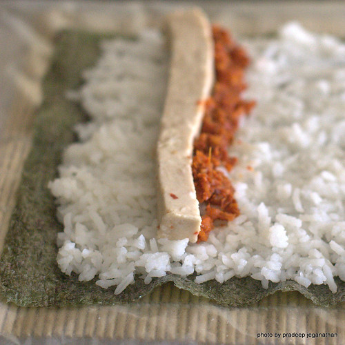 Nori sheet, spread with rice, jelled karavala and lunu-miris | by pradeep jeganathan