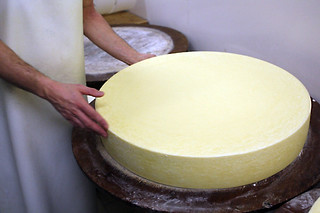 unmolding comté | by David Lebovitz