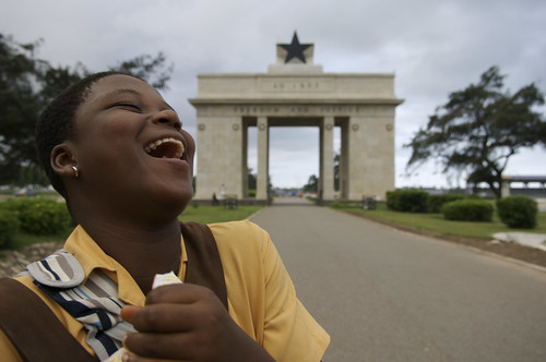 Young girl laughing in street Ghana | by World Bank Photo Collection