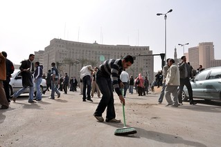29 January: A protester sweeps Tahrir Square | by Amnesty International