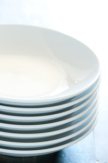 stack of white plates | by jules:stonesoup