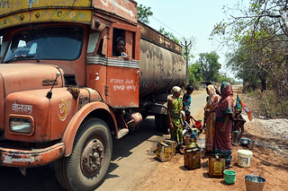 Women displaced by the Hirakud dam fill water from the tankers. These women have been struggling without a water connection for over  60 years now.