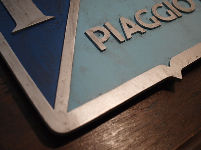 retro Piaggio logo sign