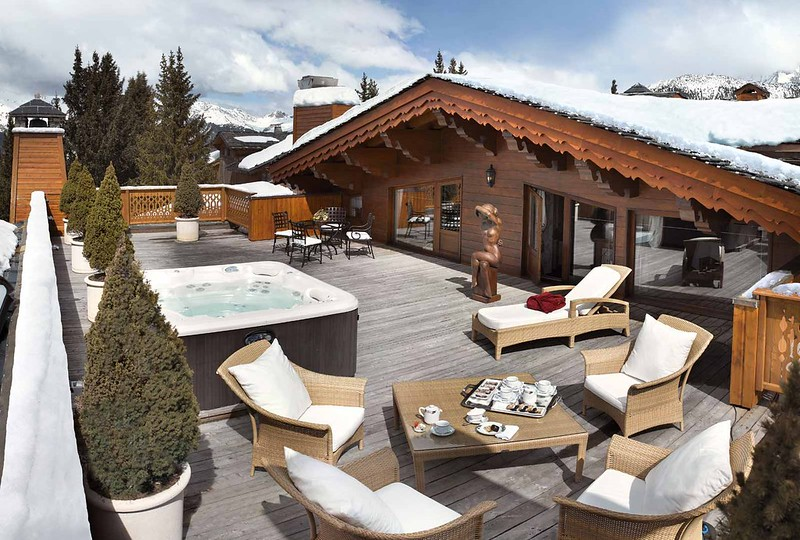 Terrace of the private penthouse apartment within the Hotel De Charme Les Airelles