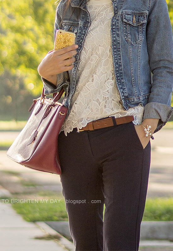 denim jacket, floral lace top, brown belt, navy pants, red purple tote, floral cuff