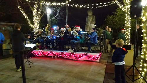 At the opening ceremony of the Greenbelt Festival of Lights. The band performs Christmas music.